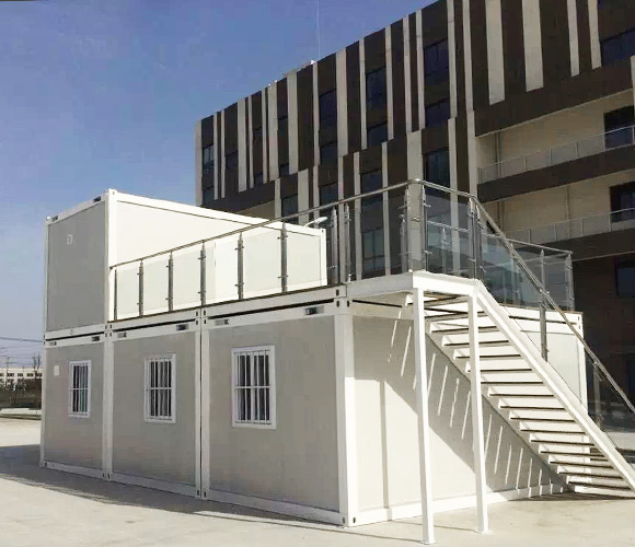 Designed container house with stairs under the blue sky