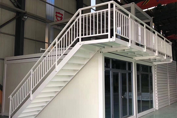Container house with stairs in two floors