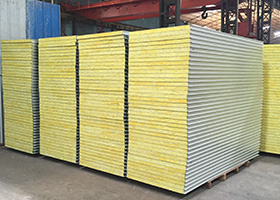 Four piles of material used to make container house
