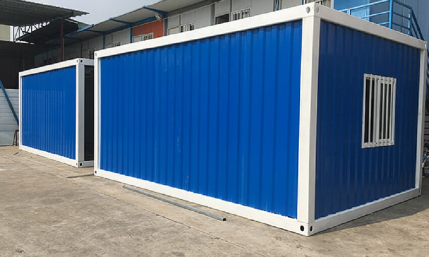 side of a blue Detachable Shipping Container House with windows and a door