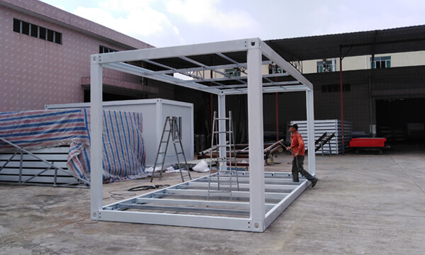 workers assembling a container house frame