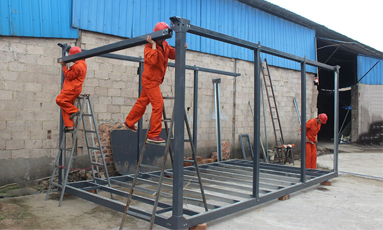 workers installing detachable container house