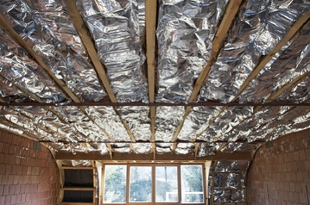 Fiberglass insulation installed in the sloping ceiling of a house