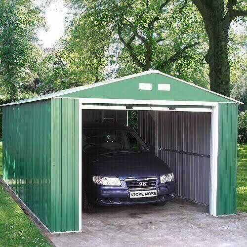 Portable carport in green with a car in it